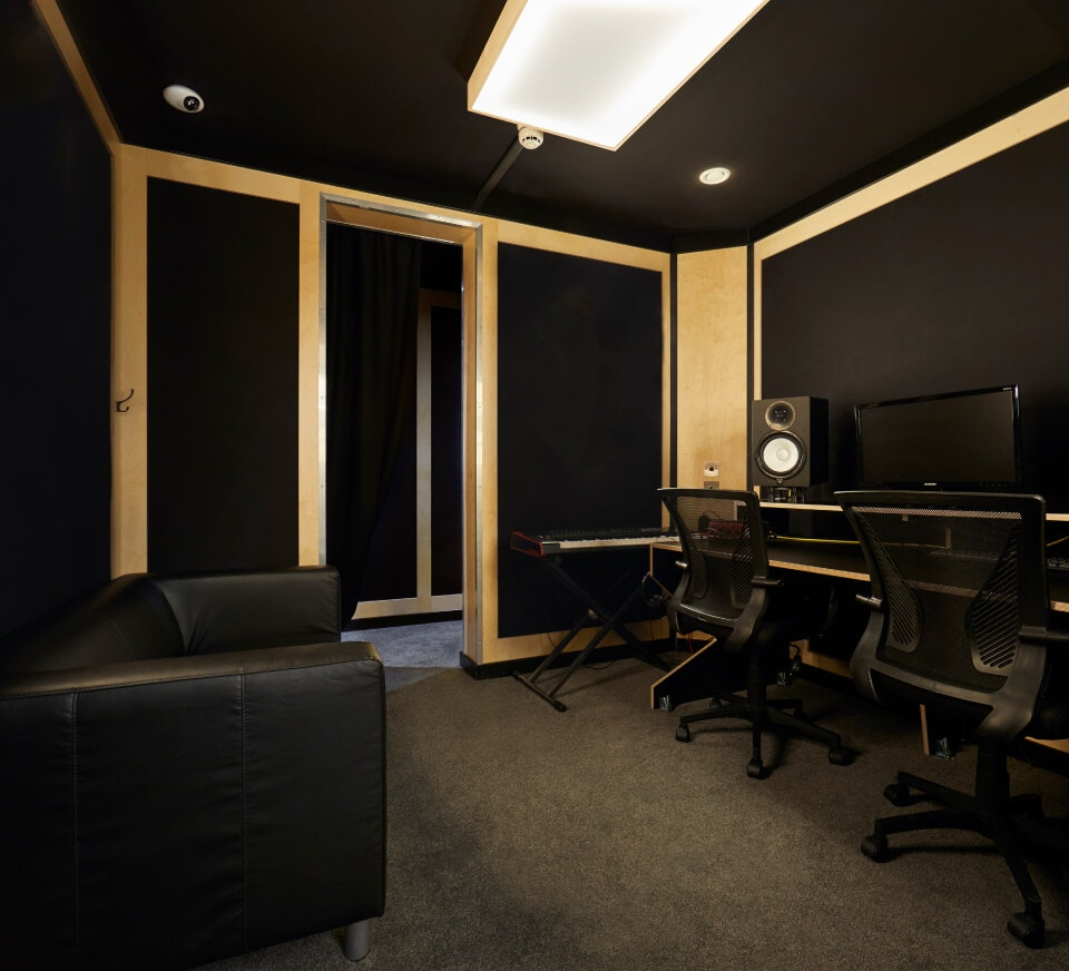A typical voice over studio. Studio monitors, audio interface, condenser microphones and more provided free in all audio recording studios