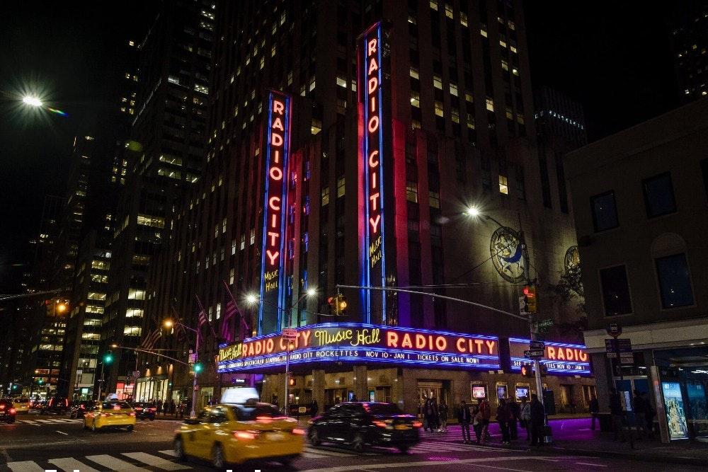 This image may contain: metropolis, urban, city, building, car, downtown, person, road, lighting, tarmac
