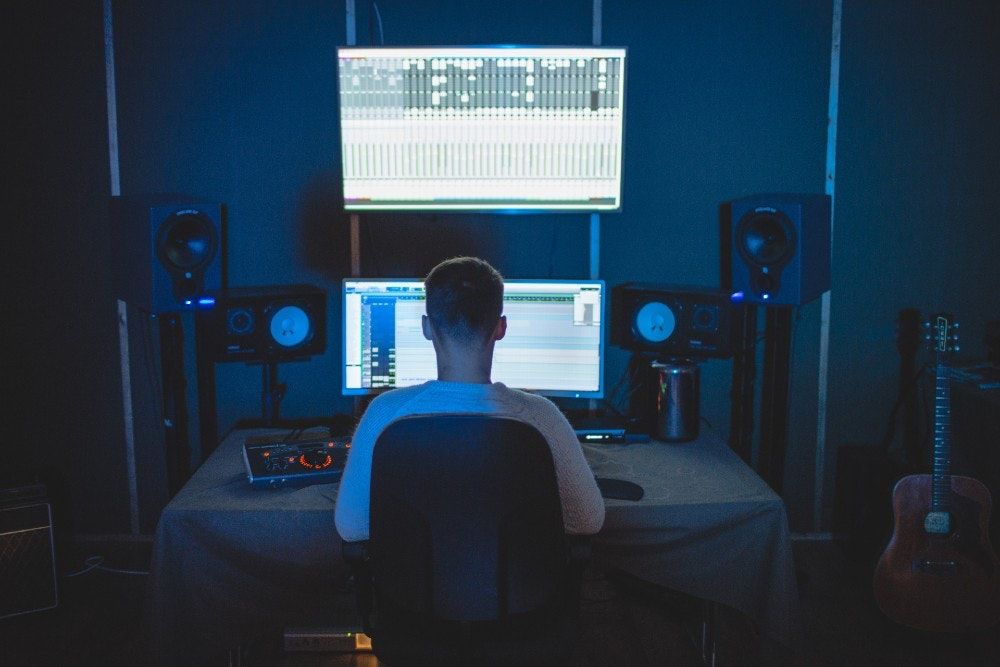 Producer using a recording studio for music production in NY