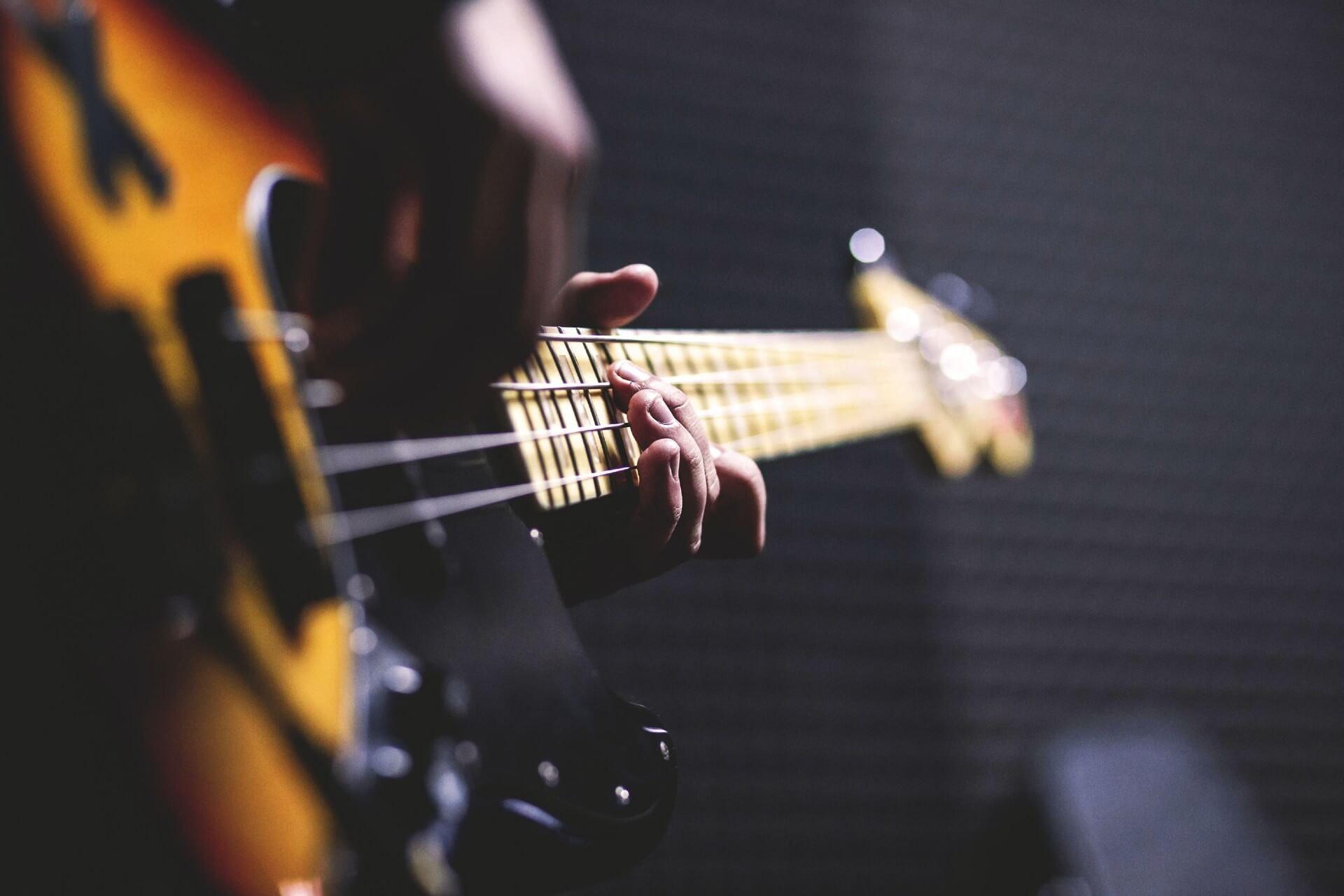 Guitar player using guitar studios. Book your creative guitar studio easily online today.