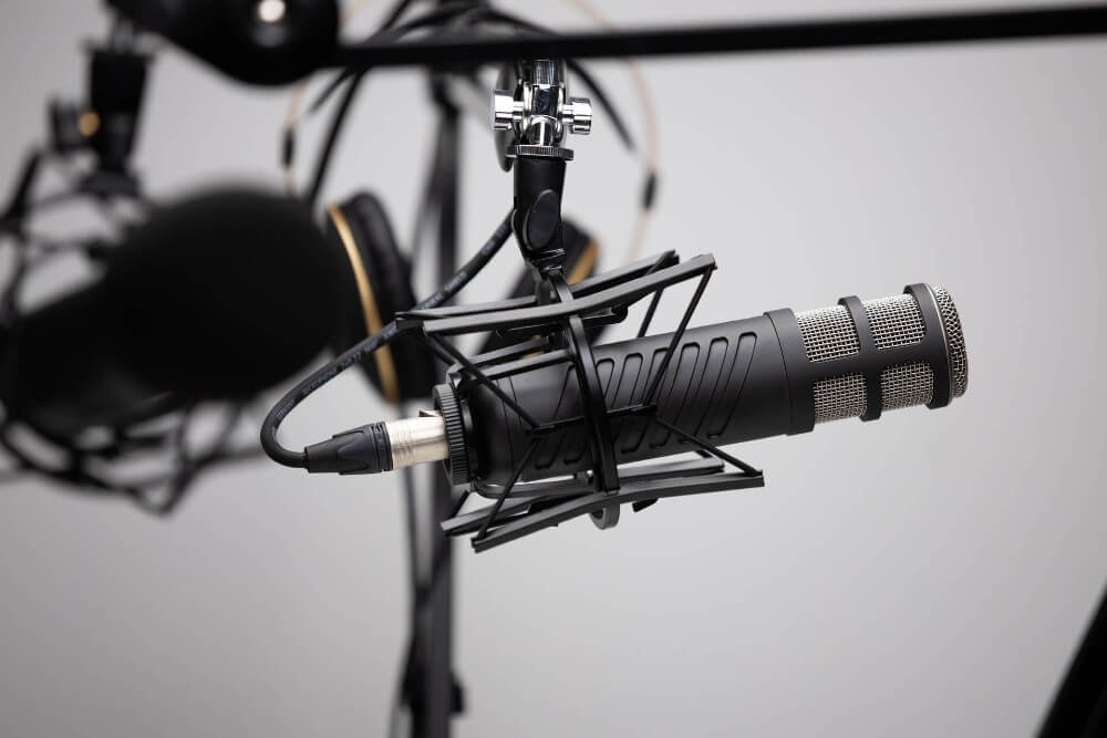 Close up of a podcast mic. Book your LA podcast studio online today and boost your career in the LA podcast scene.