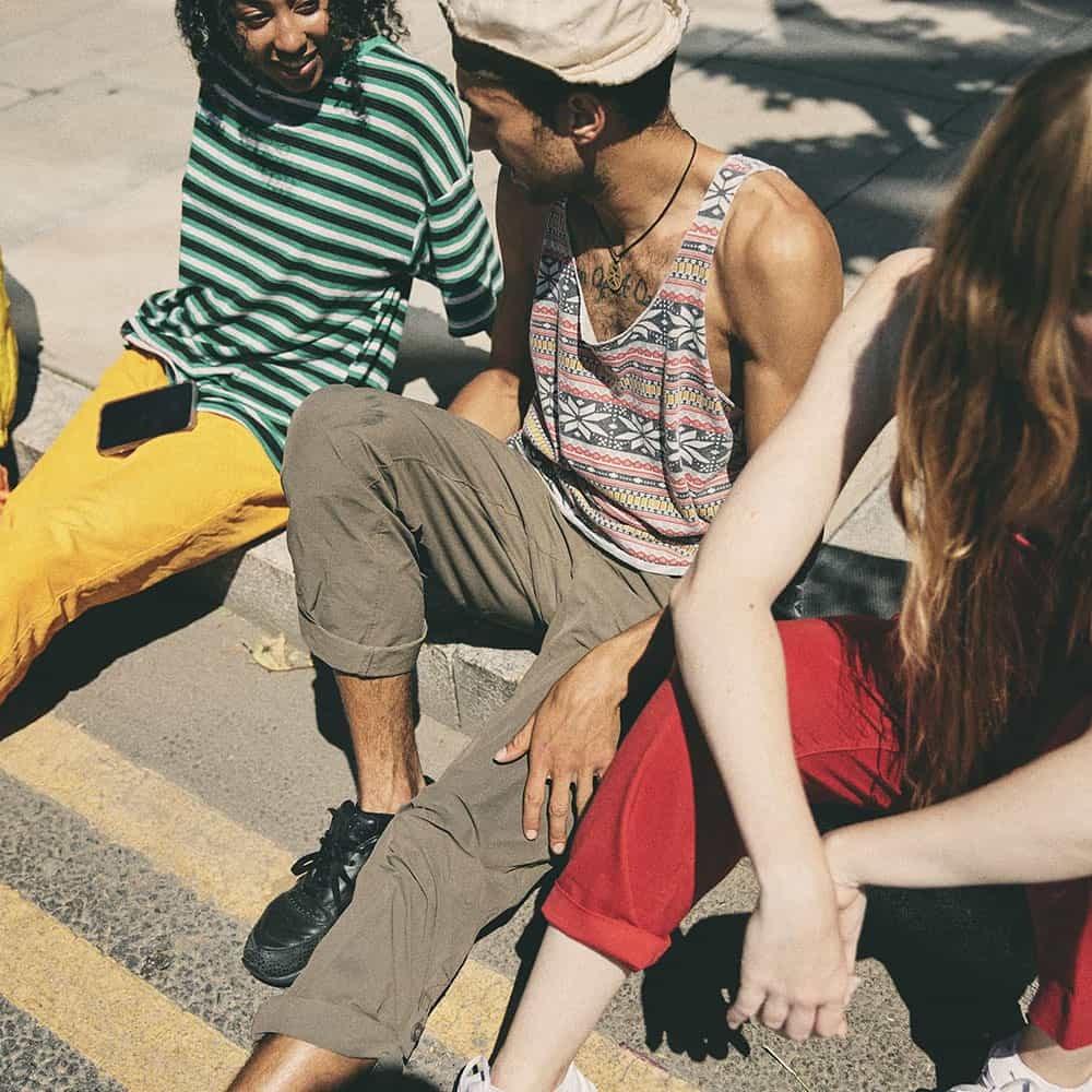 This image may contain: clothing, apparel, shoe, footwear, person, human, tarmac, asphalt, road