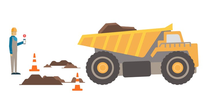 Dump truck with dirt and worker