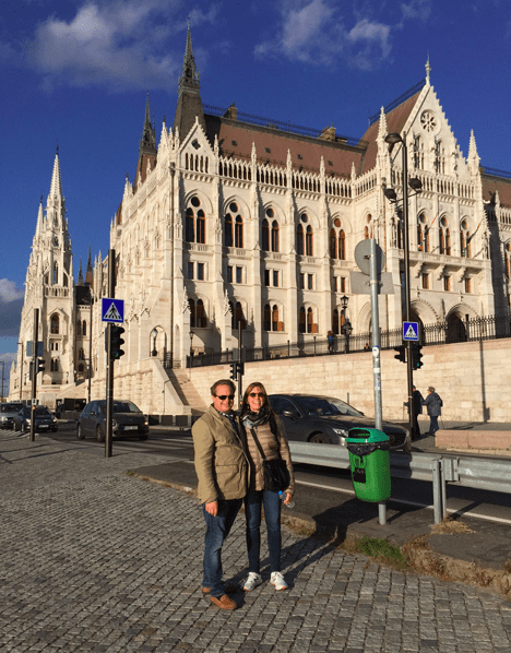 Two People in front of Parliament of Budapest