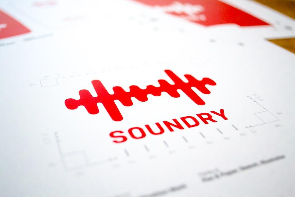 Bold red soundwave logo