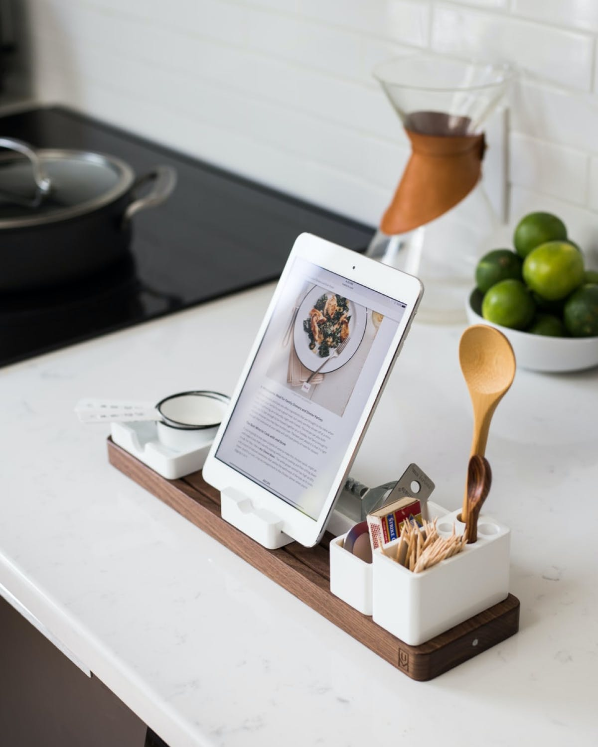 Tablet standing on a marbel kitchen countertop