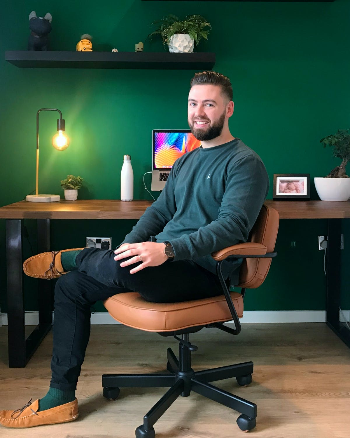 Rob Simpson sat on office check at his desk