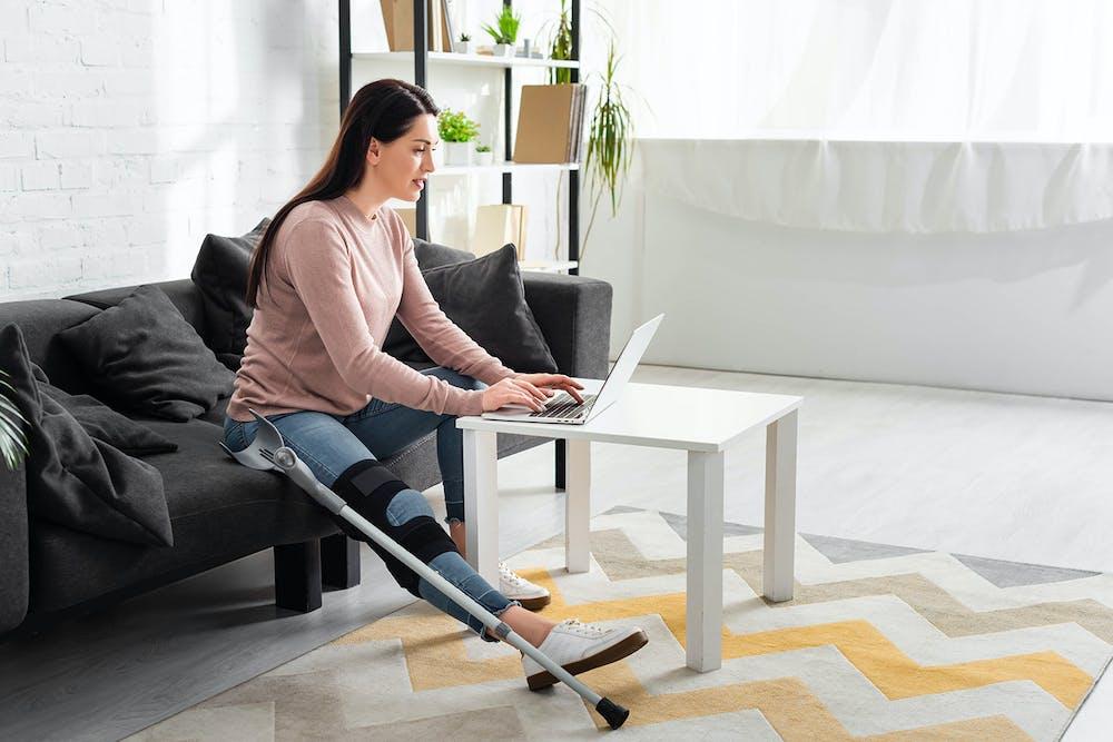 Injured woman on laptop