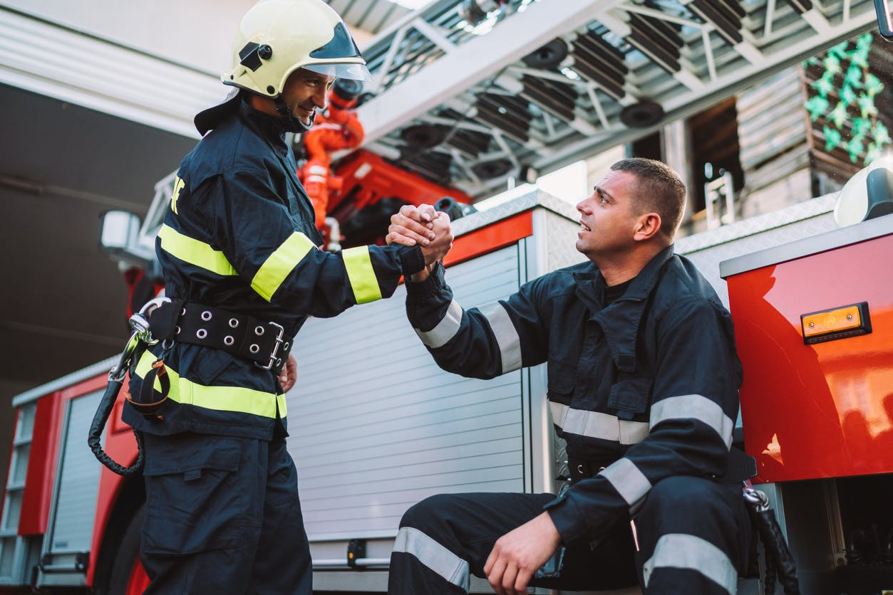 Two firefighters shaking hands