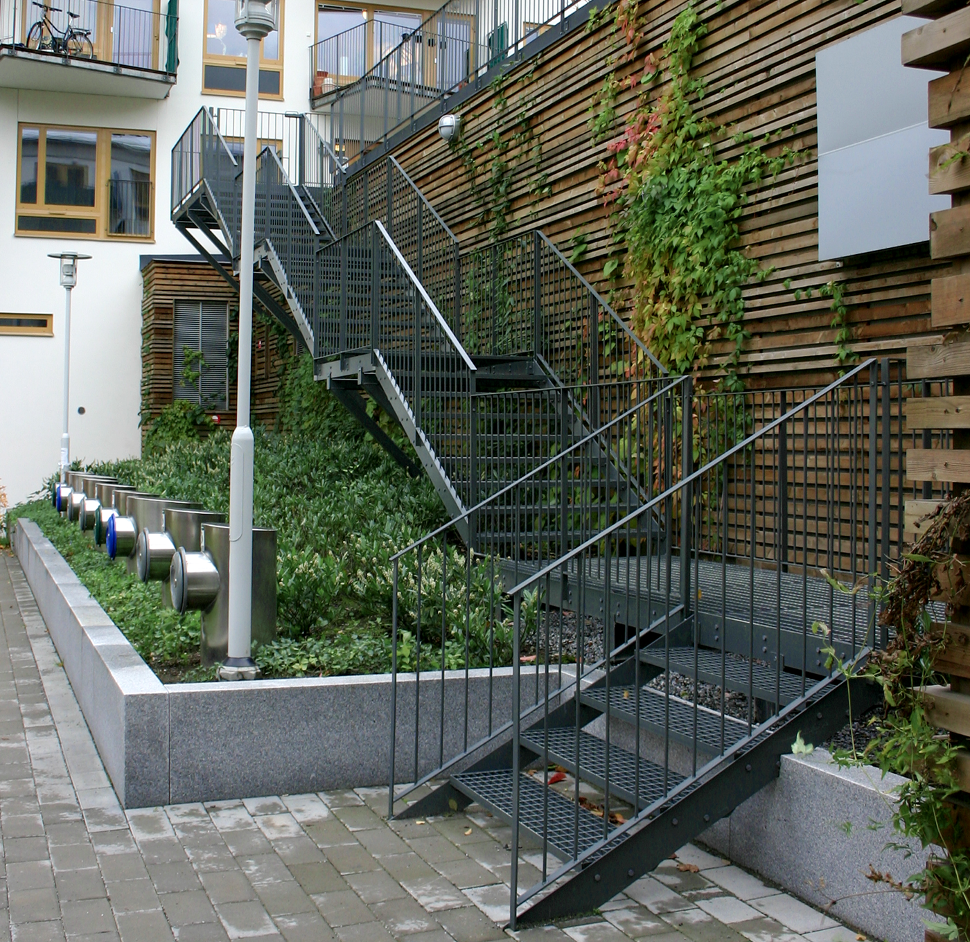Powder coated straight staircase with grating steps