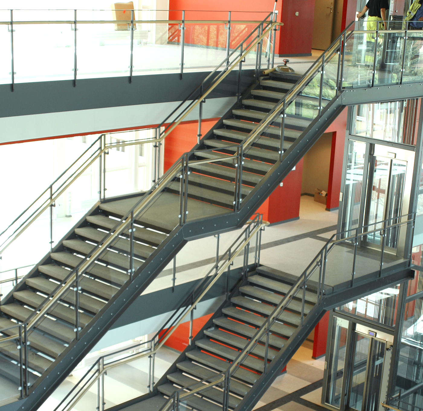 Glass railing with wooden inner handrail