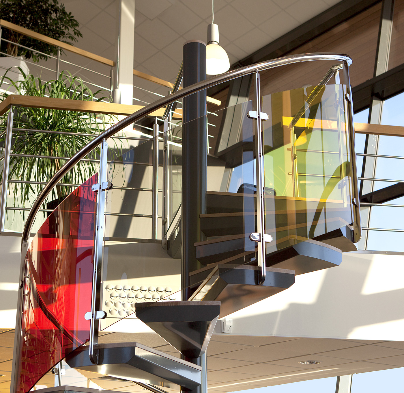 Spiral staircase exclusive indoors with glass railing