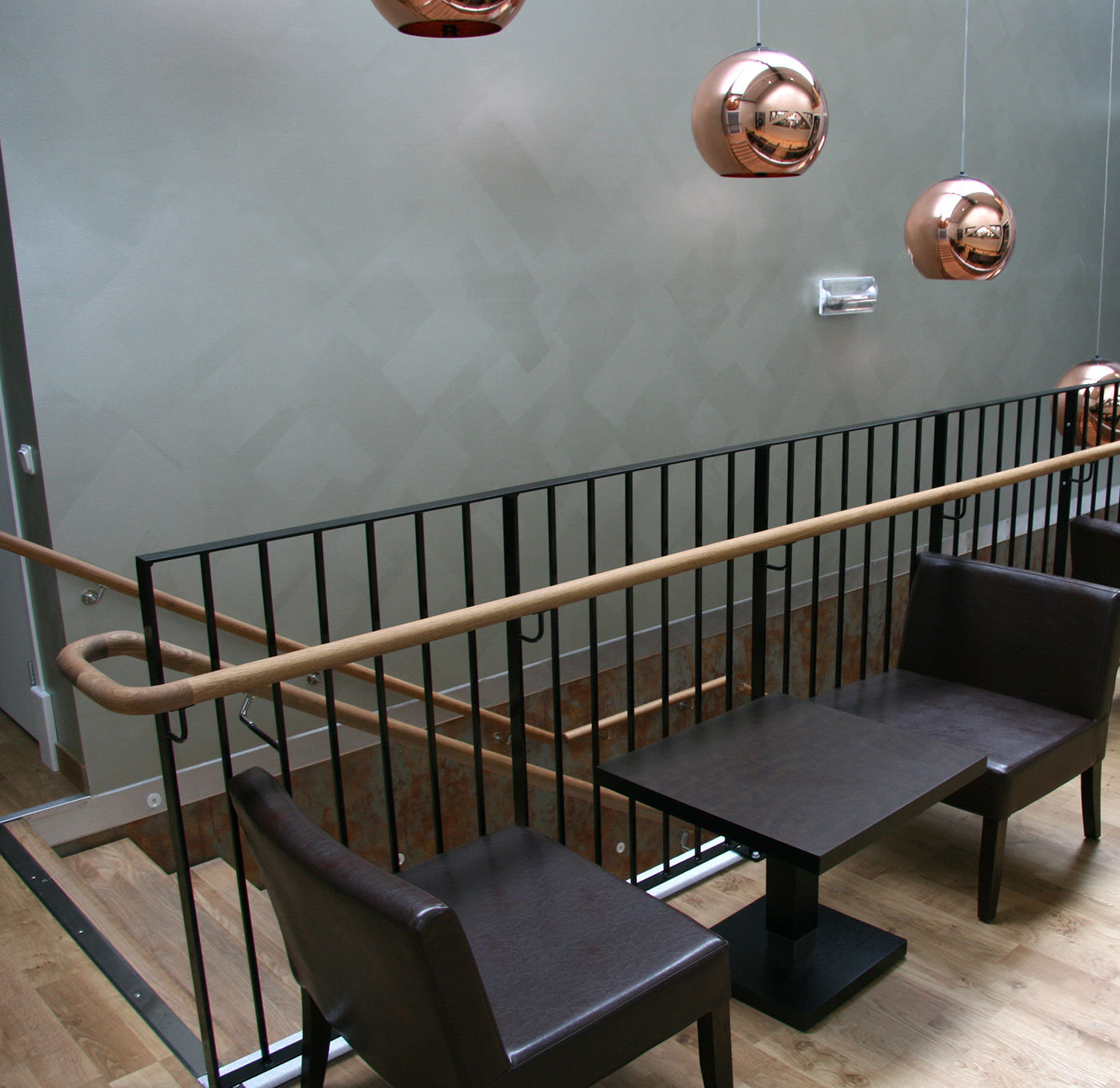 Powder coated railing with wooden handrail