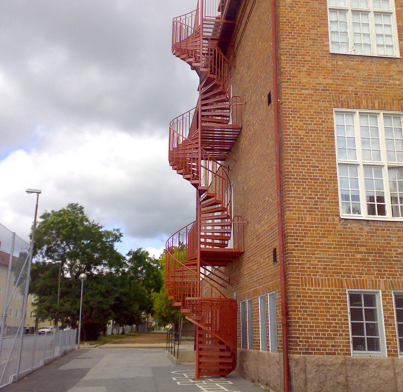 Powder coated spiral staircase with standard quarter cage