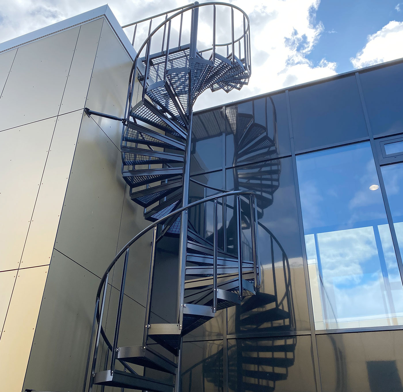 Powder coated spiral staircase with industrial railing