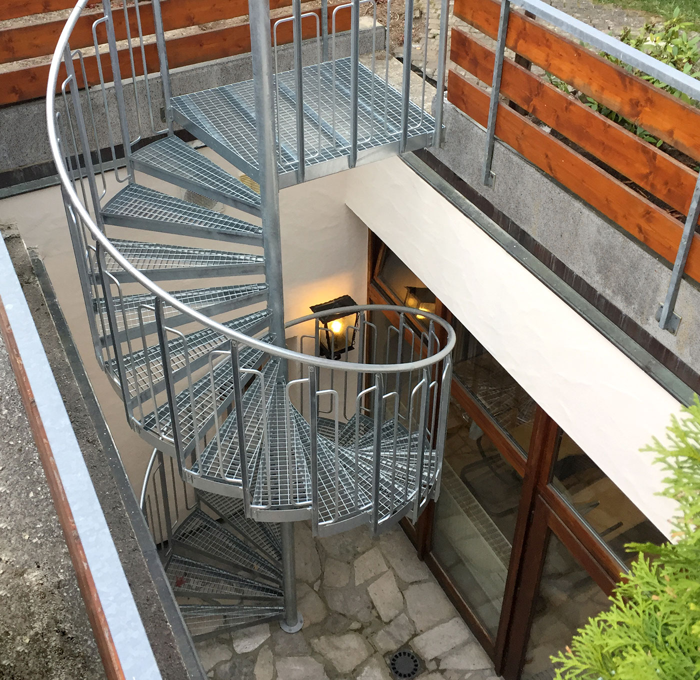 Spiral staircase with childsafe railing and steps of grating