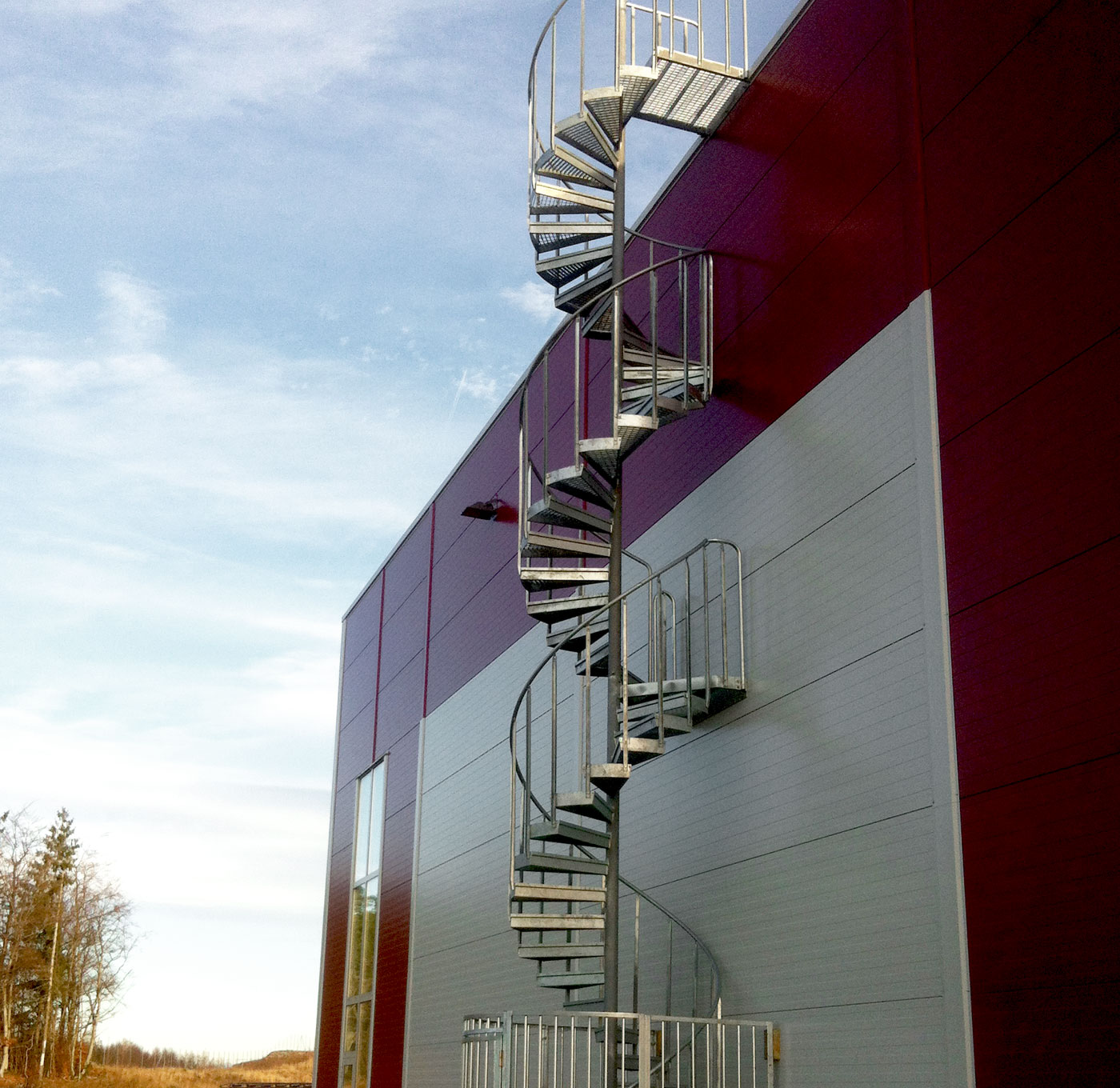 Spiral staircase standard outdoors with steps of grating