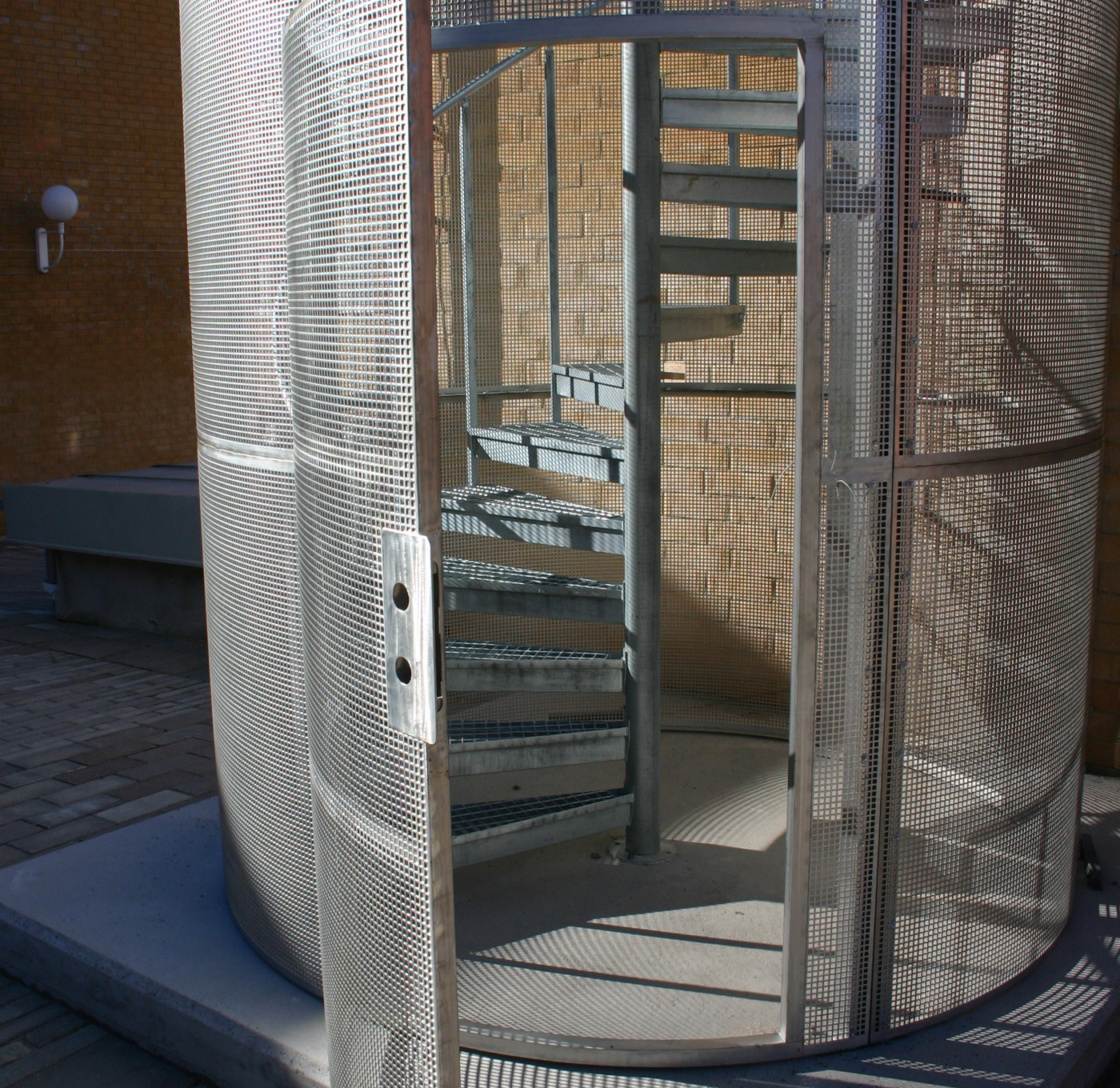 Ground connected protective cage spiral staircase