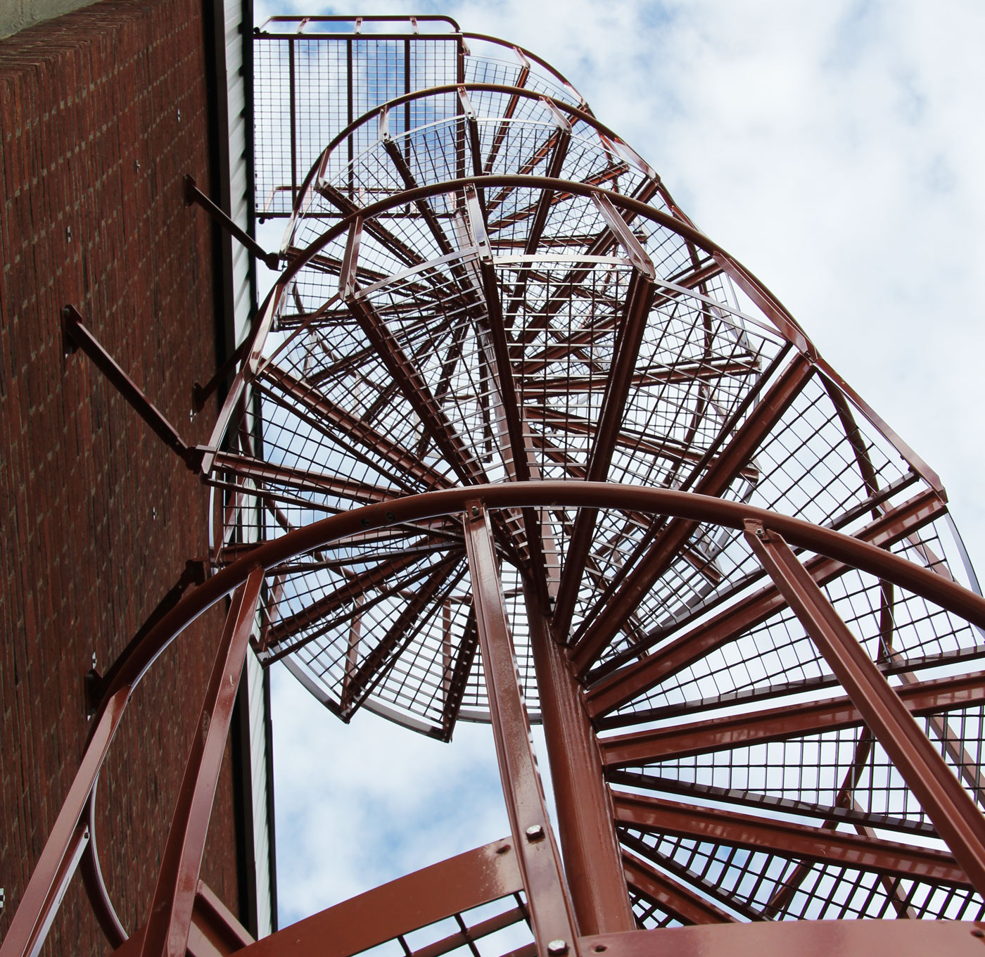 Powder coated outdoor spiral staircase with industrial railing