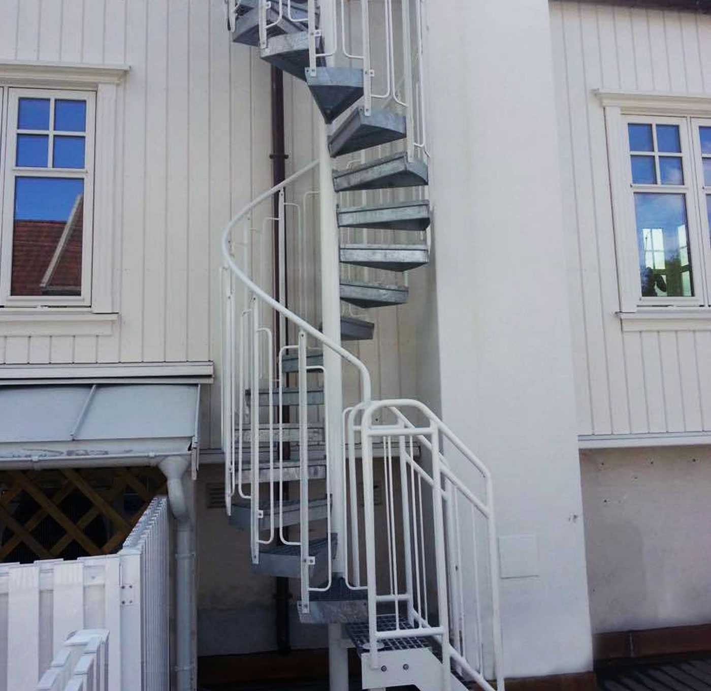 Slim powder coated spiral staircase outdoors