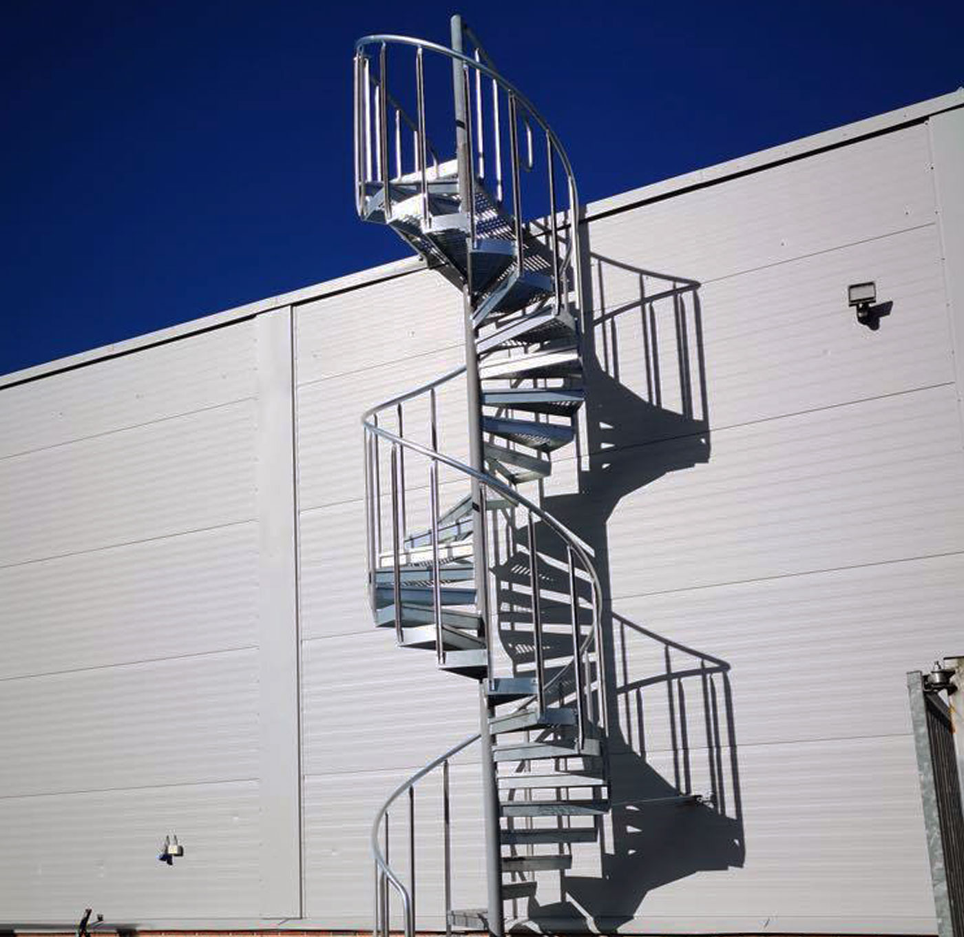 Spiral staircase outside with industrial railing