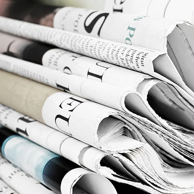 Newspapers Piled Neatly