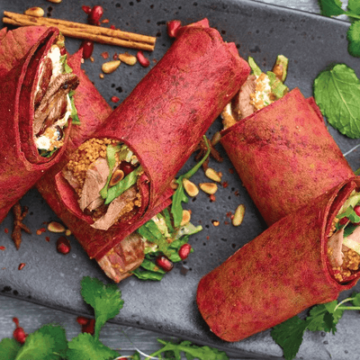 5 sliced purple beetroot wraps filled with middle eastern spiced lamb and couscous