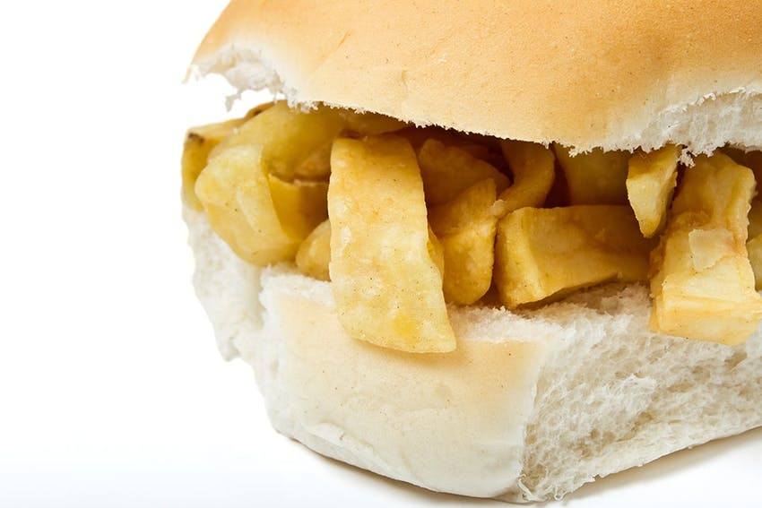 fluffy white rolled halved and filled with traditional british crunchy yet fluffy chip shop chips