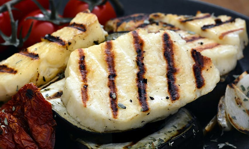 thick slices of chargrilled halloumi next to vine cherry tomatoes
