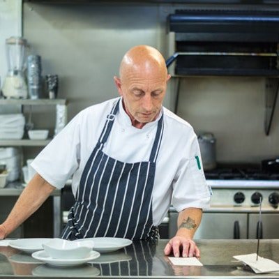 chef alan of the beresford arms in the pub kitchen reviewing menus