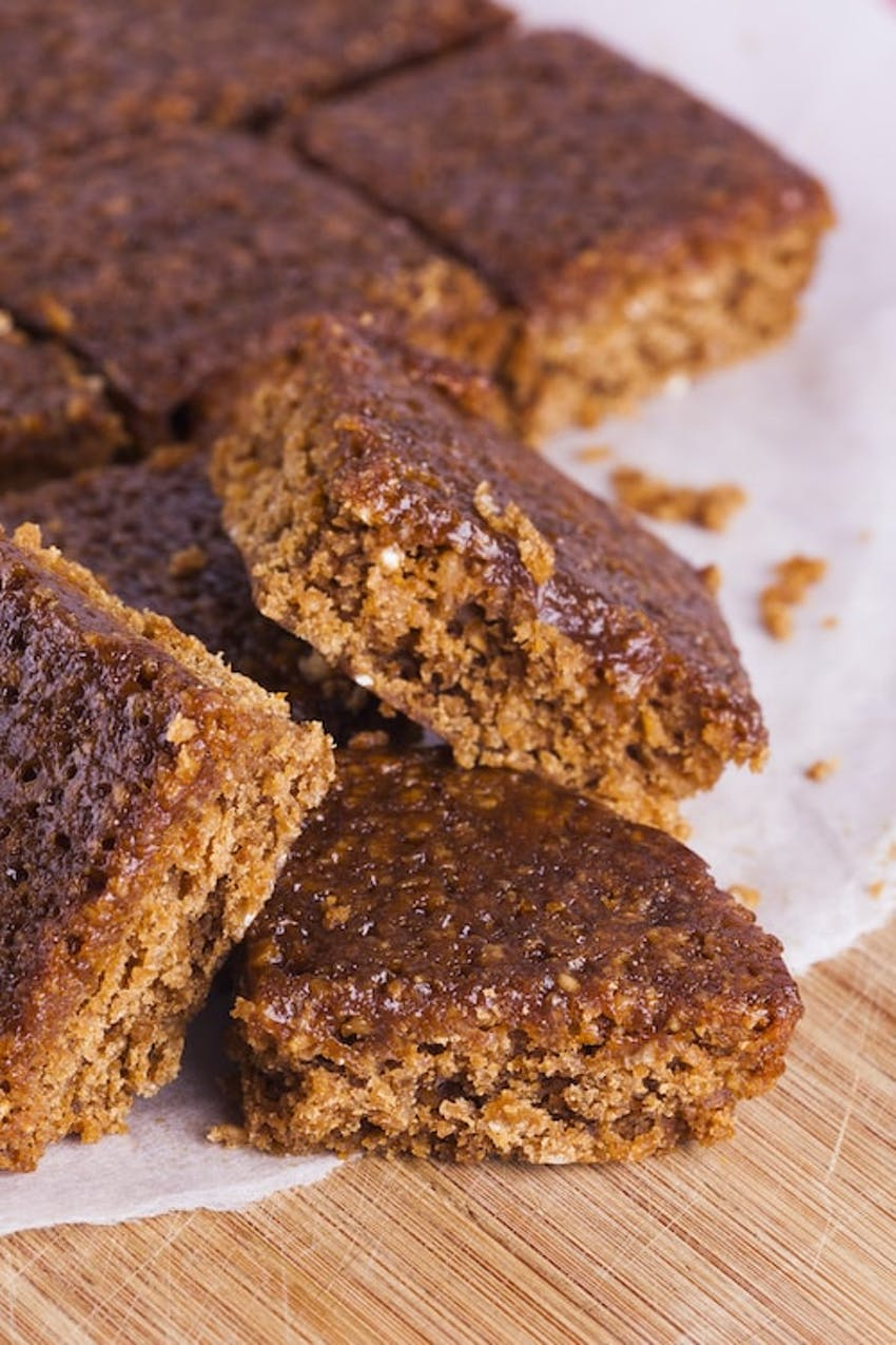 Gooey parkin cake chopped up and stacked on top of each other