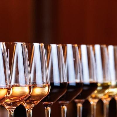 twelve wine glasses in a diagonal line