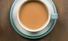 birds eye view of a nice strong english breakfast tea in a blue and white cup and saucer
