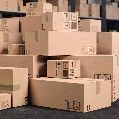 Stacked cardboard boxes in warehouse