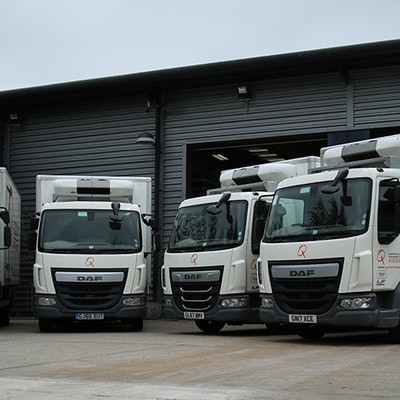 Q Catering Lorries Parked Up outside Warehouse