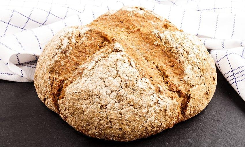 a loaf of freshly baked crusty soda bread