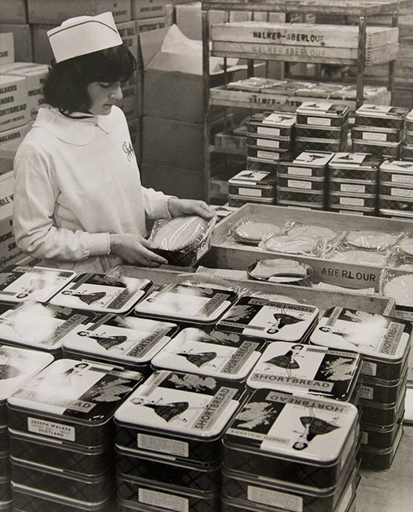 Lady packing the first shortbread tins at the original bakery