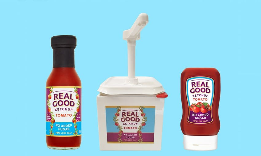 three different bottles of real good ketchup with a blue background