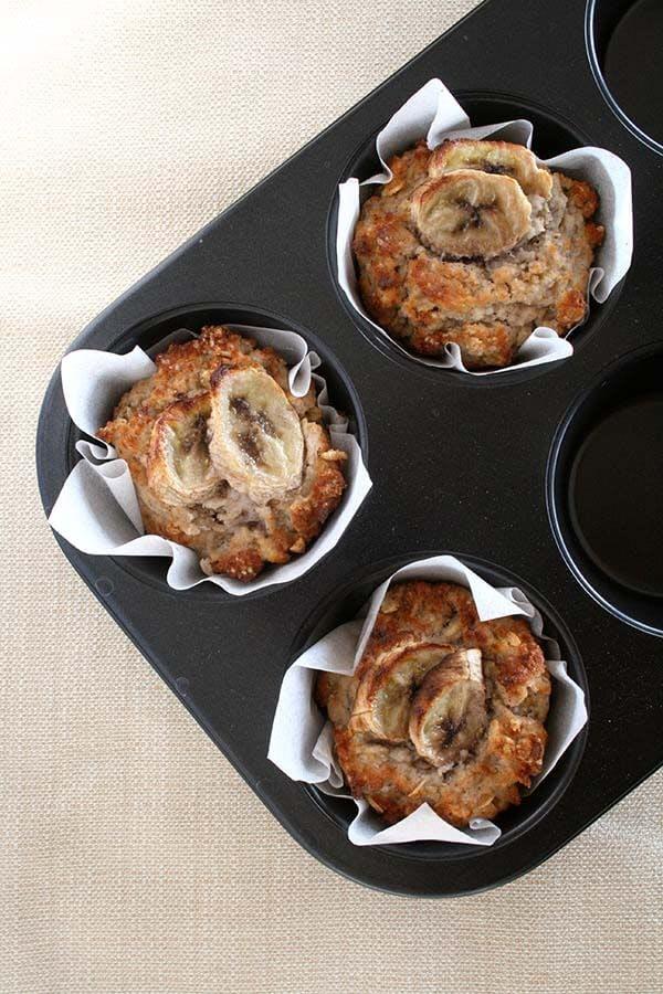 three crispy banana breakfast muffins in a baking tray