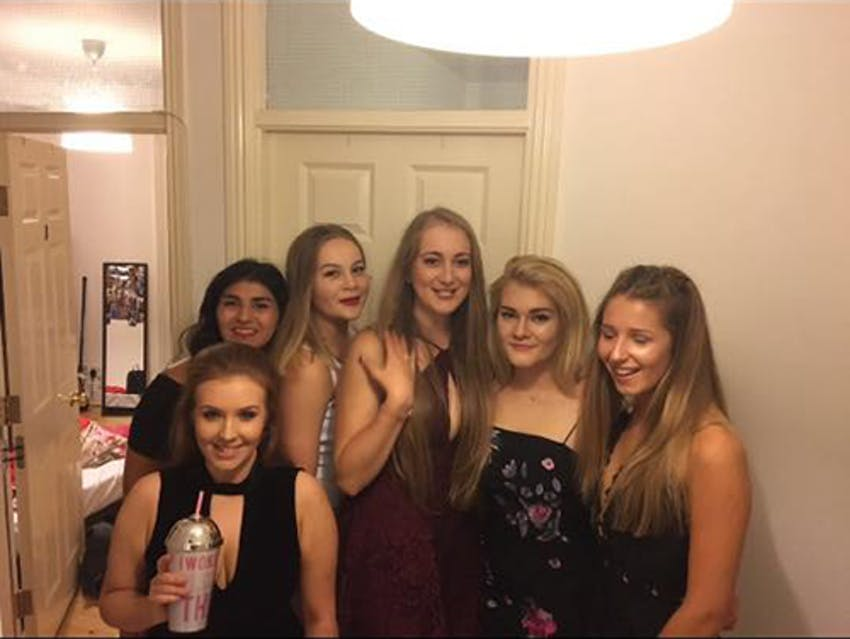 a group of young girls in a university house before a night out