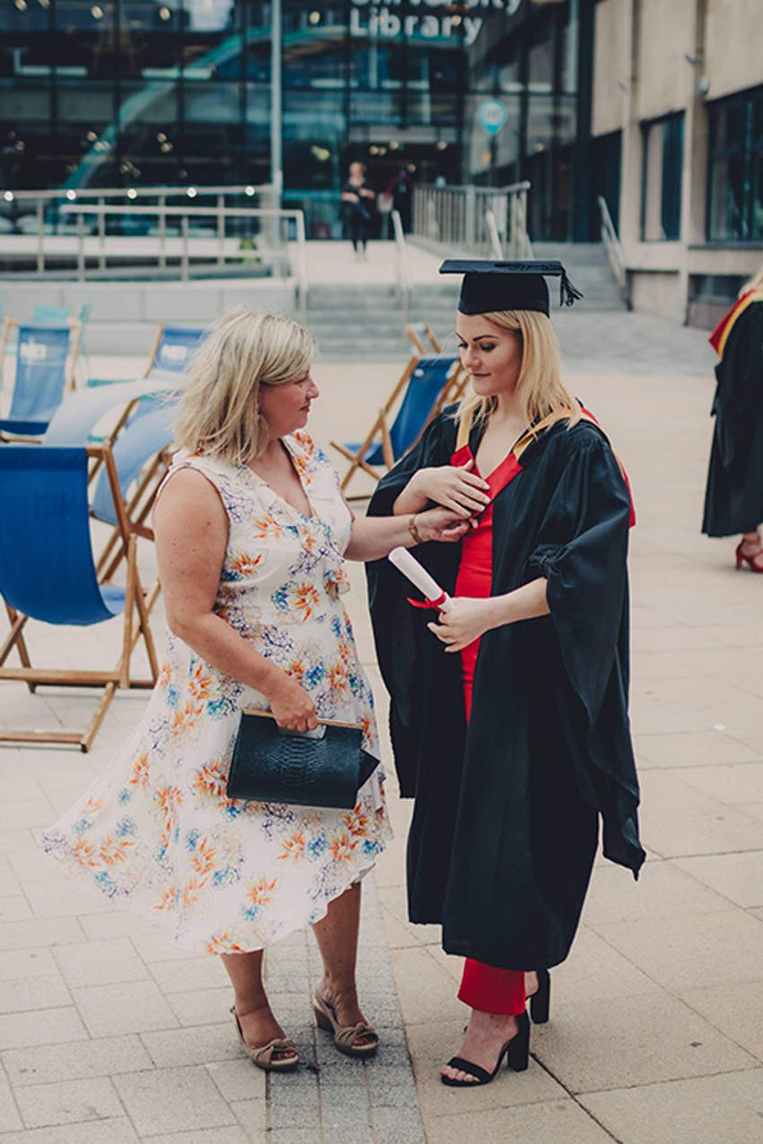 young girl and her mum at graduation ceremony