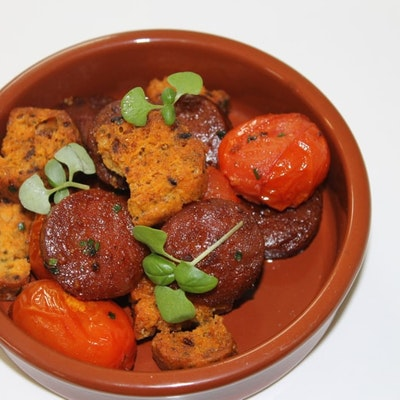 tapas dish filled with chorizo, tomato and chorizo, pepper and tomato biscotti