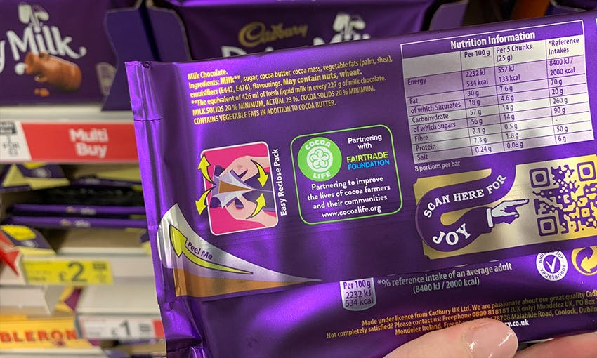 back of dairy milk family bar of chocolate showing the products ingredients, allergen information and nutritional content