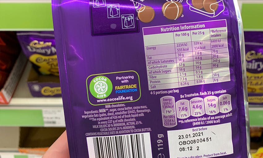 back packaging, ingredients lists and nutritional content of a pack of dairy milk buttons