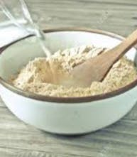 Dry ingredients being mixed together in a large white bowl