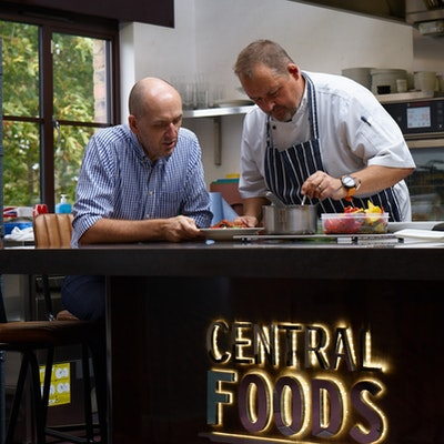 gordon lauder and head chef of central foods stand in the new innovation kitchen desk with lot