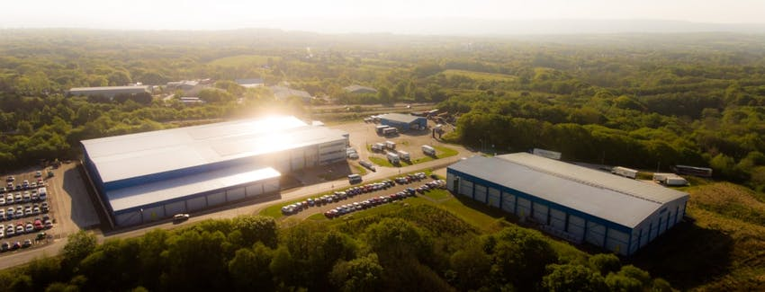 a drone view of the castell howell warehouse depot in the middle of the countryside in cross hands