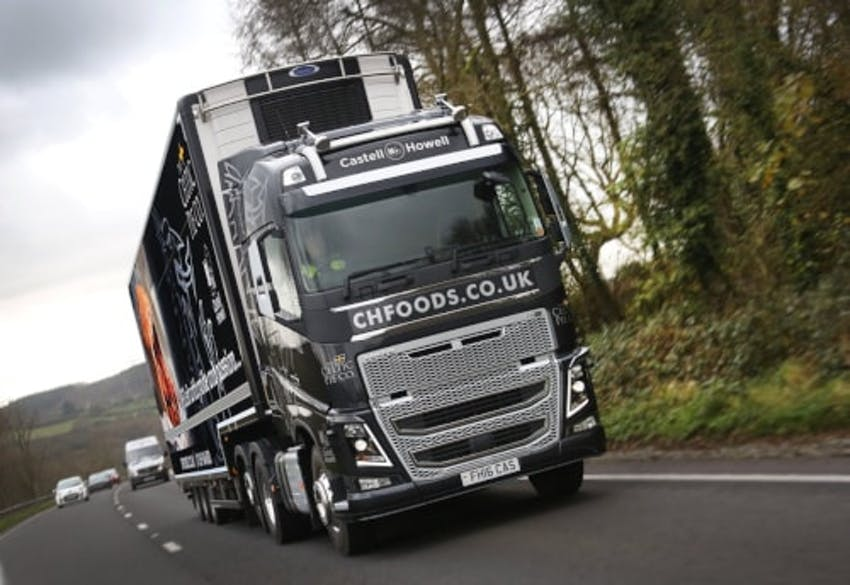 black and silver castell howell lorry driving through the countryside