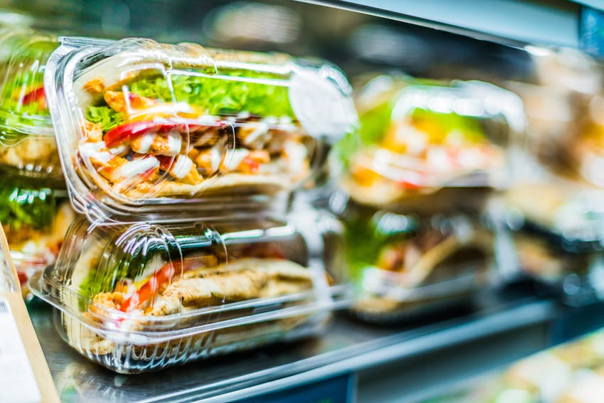 freshly made sandwiches packaged in plastic containers on shelves