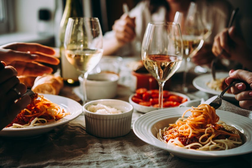 pasta dishes and wine in restaurant